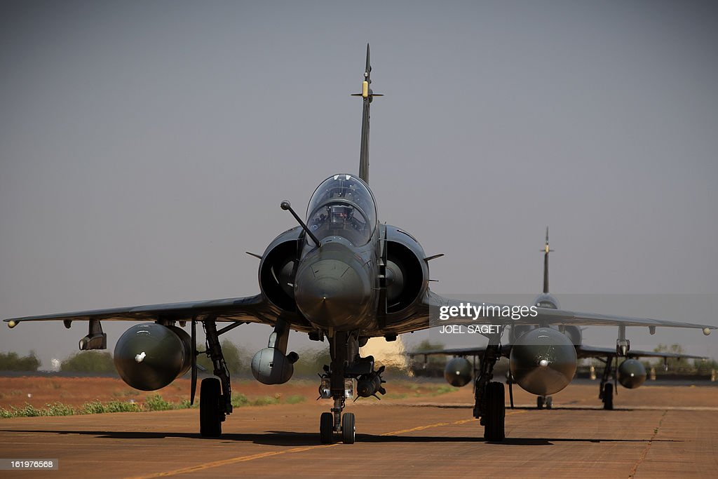 French Mirage 2000 D fighter jets of the Nancy-based 3/3 Fighter Squadron Ardennes taxi on February 18, 2013 at Bamako's airport after a Close Air Support (CAS) mission. European Union foreign ministers on February 18 formally approved the launch of a 500-strong EU military mission to train the Malian army, which has already begun work on the ground. France launched its intervention on January 11, after Mali's interim government called for help fending off the Islamist insurgents as they began to make incursions into government territory.