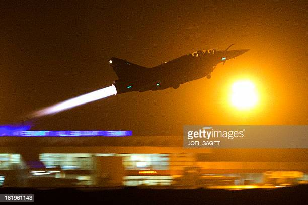 A French Mirage 2000 fighter jet of the Nancybased 3/3 Fighter Squadron Ardennes takes off early on February 18 2013 for a Close Air Support mission...