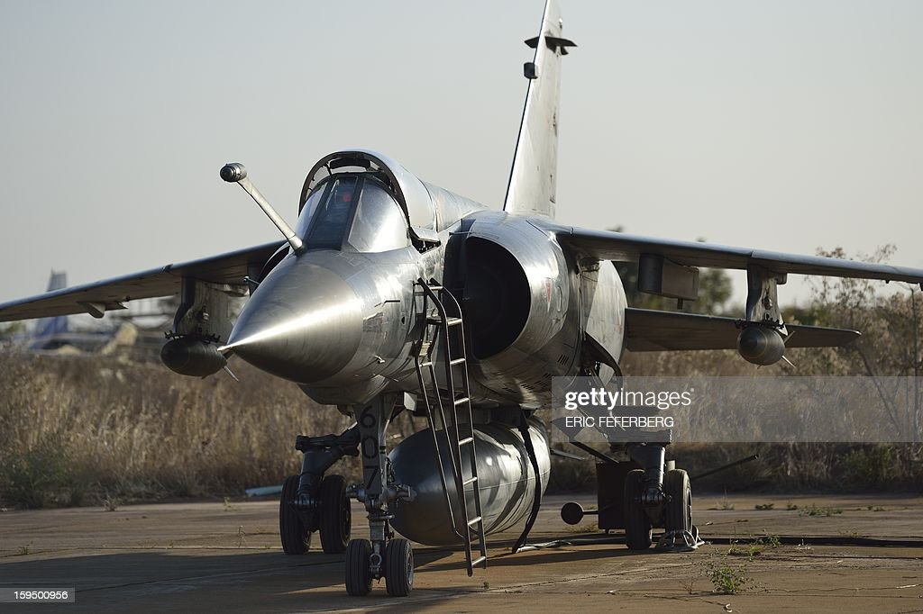 A French Mirage F1 CR fighter aircraft, coming from N'Djamena (Chad), is seen at the 101 military airbase near Bamako on January 14, 2013. France is using air and ground power in a joint offensive with Malian soldiers launched on January 11 against hardline Islamist groups controlling northern Mali. AFP PHOTO /ERIC FEFERBERG