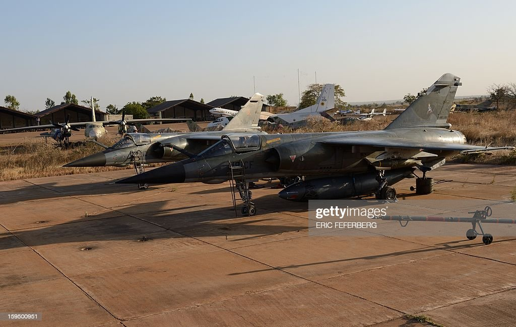 French Mirage F1 CR fighter aircrafts, coming from N'Djamena (Chad), are seen at the 101 military airbase near Bamako on January 14, 2013. France is using air and ground power in a joint offensive with Malian soldiers launched on January 11 against hardline Islamist groups controlling northern Mali.