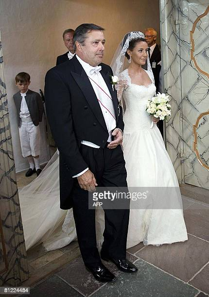 French Miss Marie Cavallier and her father Alain Cavallier arrive on May 24 2008 at Moegeltoender Church in South Jutland for Miss Cavallier's...