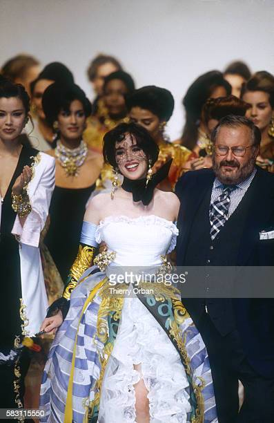 French model and actress Isabelle Adjani wears a wedding dress by Italian fashion designer Gianfranco Ferre in the 1993 SpringSummer fashion show for...