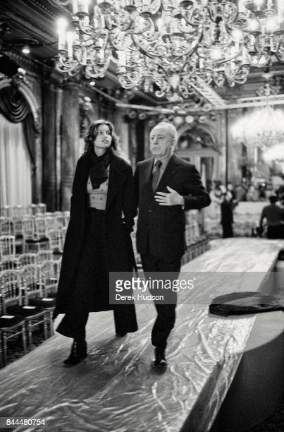 French model and actress Laetitia Casta and fashion patron Pierre Berge walk the catwalk during preparations for a Yves Saint Laurent haute couture...
