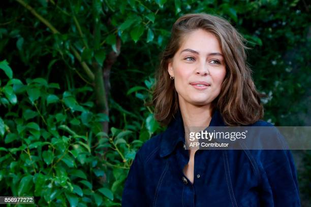 French model and actress MarieAnge Casta poses during a photocall prior to the Chanel women's 2018 Spring/Summer readytowear collection fashion show...