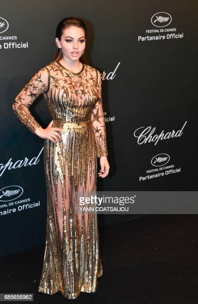 French model and actress Thylane Blondeau poses as she arrives for the Chopard 'Space' party on the sidelines of the 70th Cannes film festival on May...