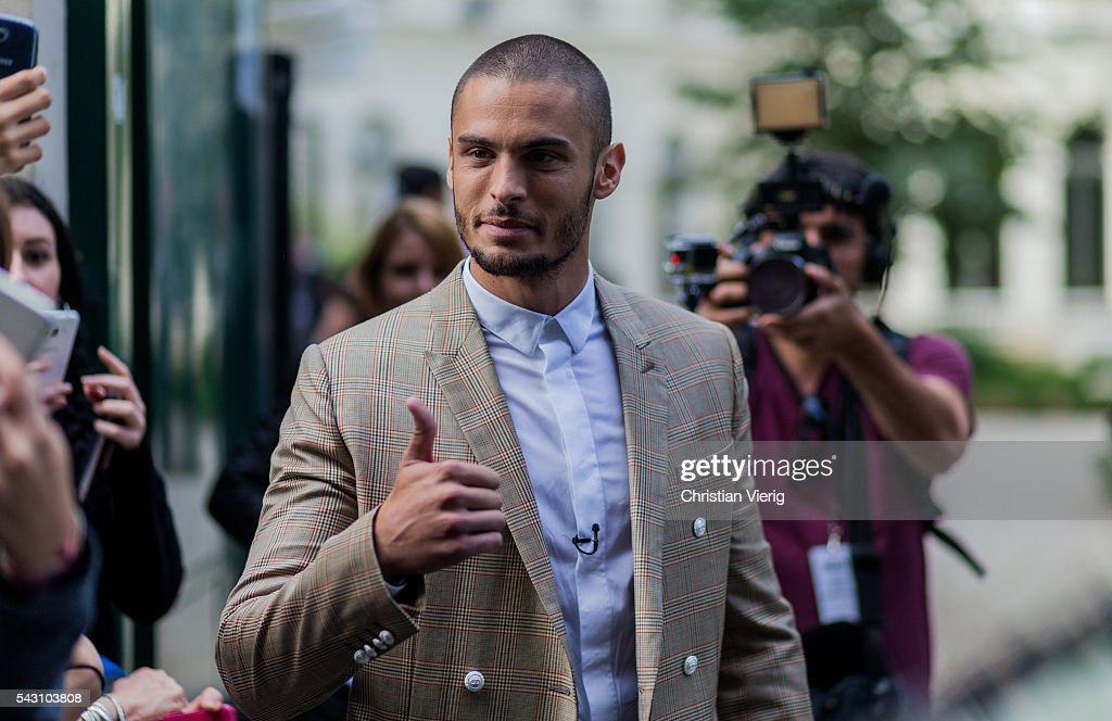 French model and singer <a gi-track='captionPersonalityLinkClicked' href=/galleries/search?phrase=Baptiste+Giabiconi&family=editorial&specificpeople=5770755 ng-click='$event.stopPropagation()'>Baptiste Giabiconi</a> outside Balmain during the Paris Fashion Week Menswear Spring/Summer 2017 on June 25, 2016 in Paris, France.