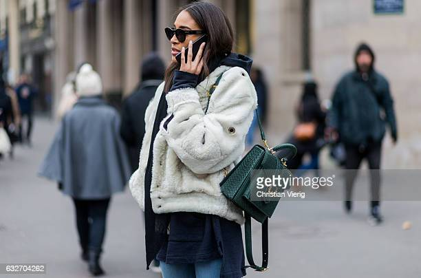 French model Cindy Bruna wearing a white fur jacket black scarf green bagpack outside Elie Saab on January 25 2017 in Paris Canada