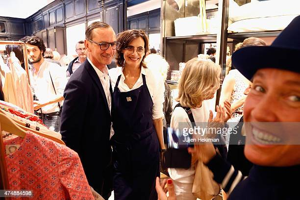 French model Ines de la Fressange attends her boutique opening with shoes designer Bruno Frisoni on May 27 2015 in Paris France