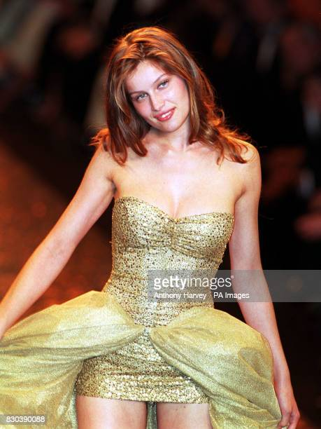 French model Laetitia Casta on the catwalk during the Victoria's Secret fashion show held during the amFAR benefit party on 18 May 2000 in Cannes