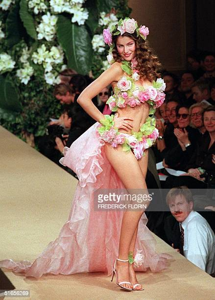 French model Laetitia Casta presents the wedding gown of Yves SaintLaurent's 1999 Spring/Summer haute couture collection in Paris 20 January