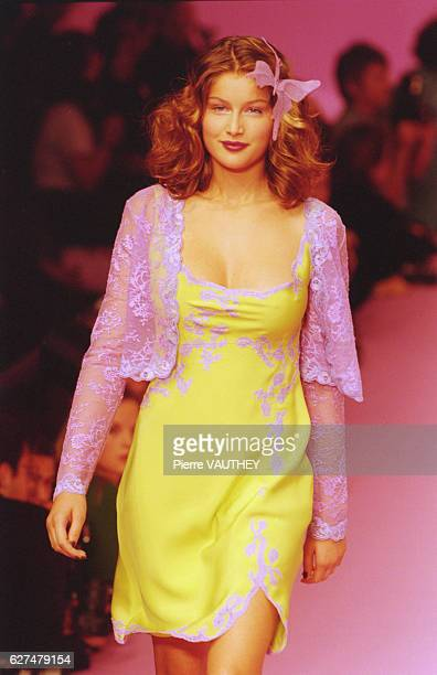French model Laetitia Casta wears readytowear women's fashions during a 1997 springsummer fashion show for French fashion house Lolita Lempicka Her...