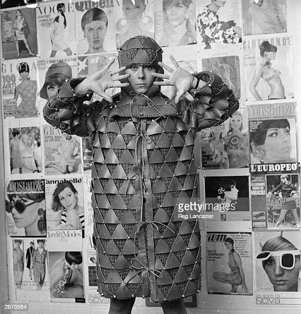 A French model wearing a knitted coat with leather patches designed by Paco Rabanne