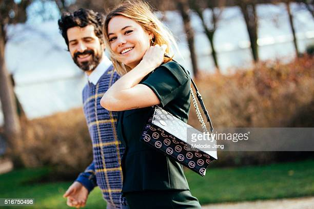 French model/actress Camille Rowe and star of the Dior Poison Girl campaign wears a green Dior suit and carries a Christian Dior bag at the Dior show...