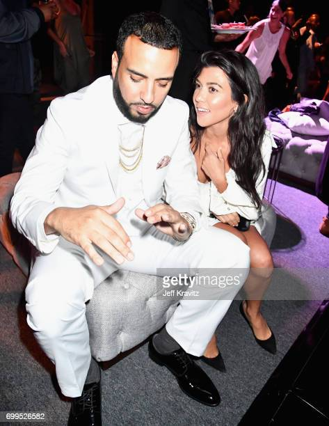 French Montana and Kourtney Kardashian toast to Sean 'Diddy' Combs and the world premiere of Can't Stop Won't Stop at the official after party...