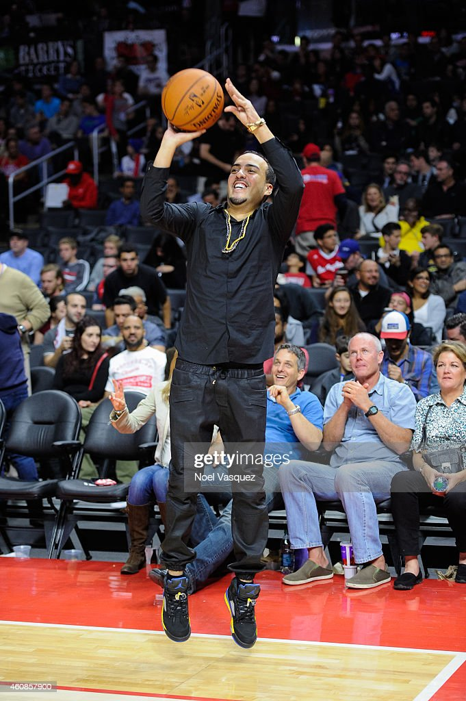 French Montana shoots a basketball at a basketball game between the Toronto Raptors and the Los Angeles Clippers at Staples Center on December 27, 2014 in Los Angeles, California.