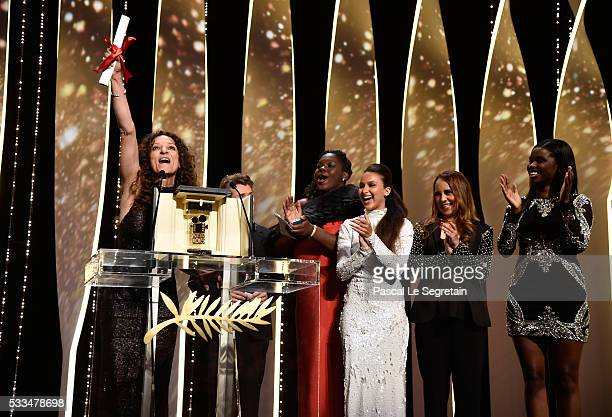 French Moroccan director Houda Benyamina acknowledges applause after being awarded with the Camera d'Or with the cast of her film 'Divines' during...