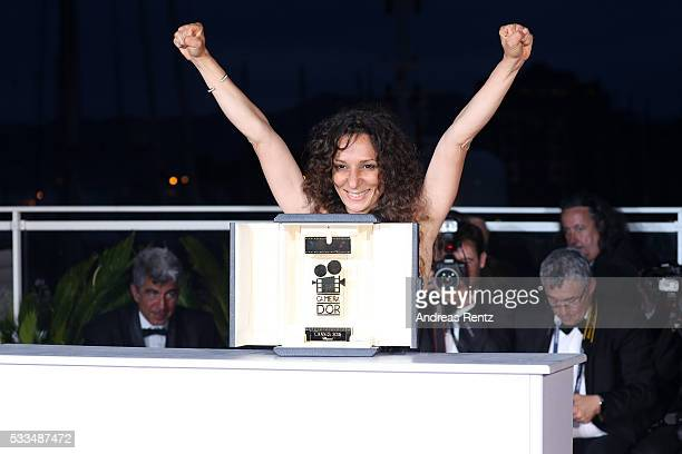 French Moroccan director Houda Benyamina poses with the Camera d'Or at the Palme D'Or Winner Photocall during the 69th annual Cannes Film Festival at...