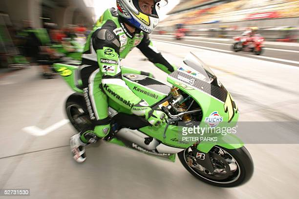 French MotoGP rider Olivier Jacque leaves the garage fo the first free practise session of the MotoGP at the Shanghai Circuit in China 29 April 2005...