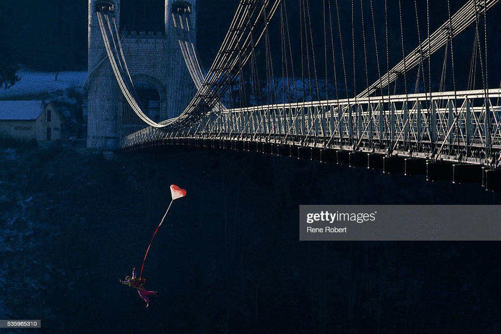 French mountain climber, paraglider, extreme skier and BASE jumper Jean-Marc Boivin jumping from the Pont de la Caille. BASE jumping is an extreme sport wherein the jumper freefalls from a fixed object, opening his parachute at the last possible moment.