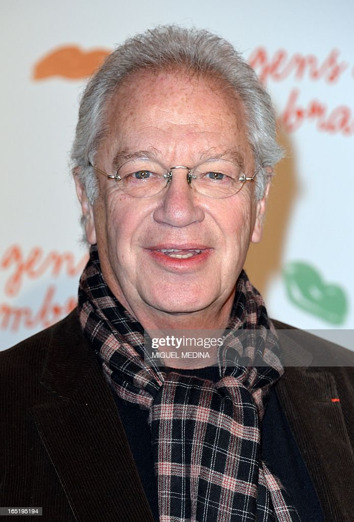 French movie director Bernard Murat poses while arriving to attend the premiere of the movie 'Des gens qui s'embrassent' (People kissing) by French director Daniele Thompson, on April 1, 2013 in Paris.