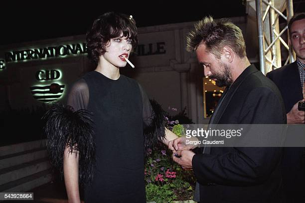 French movie director Luc Besson and fashion model Milla Jovovich enjoy an evening in Deauville The couple was married in December 1997 and filed for...