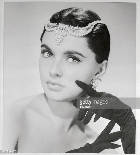 French movie starlet Yvonne De Monlaur revives a style that served silent movie queens well as she wears a fabulous diamond tiara above her brow...
