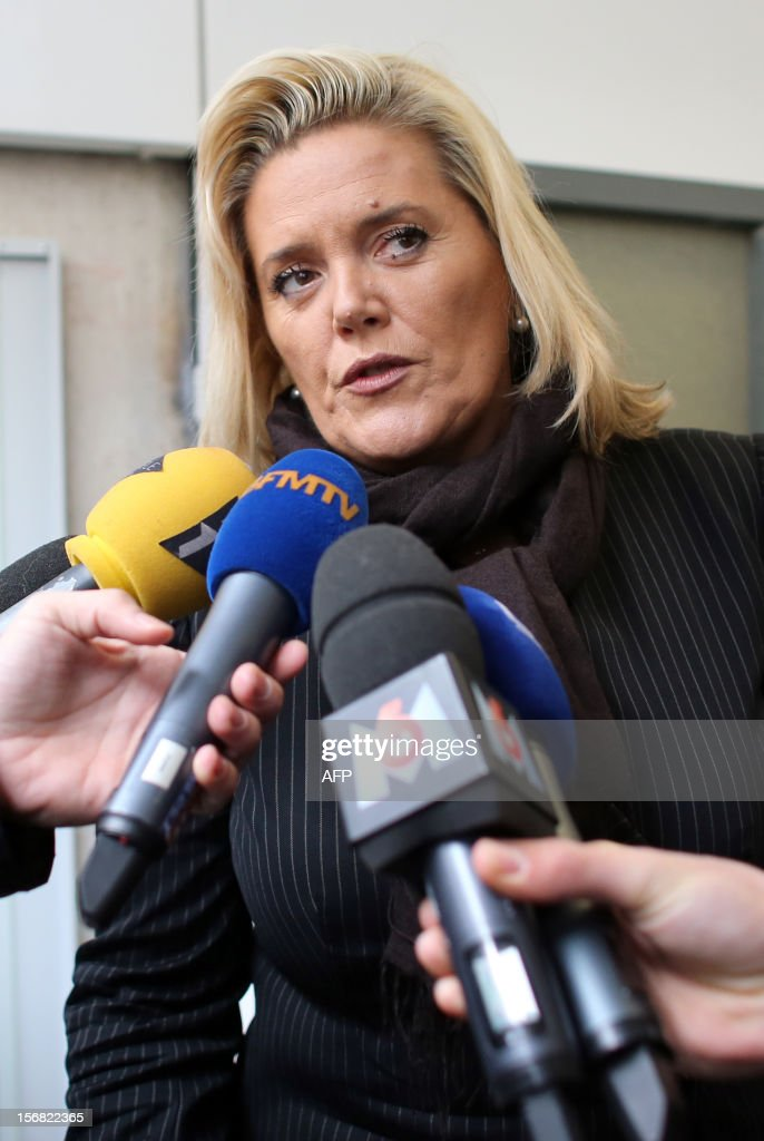 French MP and Cope's ally Michele Tabarot arrives answers to journalists' questions as she arrives at the right-wing opposition UMP party's headquarters on November 22, 2012 in Paris. Jean-Francois Cope, the head of France's right-wing UMP opposition, said an ex-prime minister was a 'sore loser' for contesting the results of a leadership vote and rejected calls for mediation.
