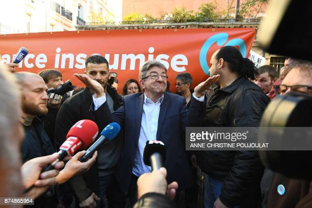 French MP and leader of the leftist party La France Insoumise JeanLuc Melenchon gestures surrounded by journalists during a nationwide protest day...