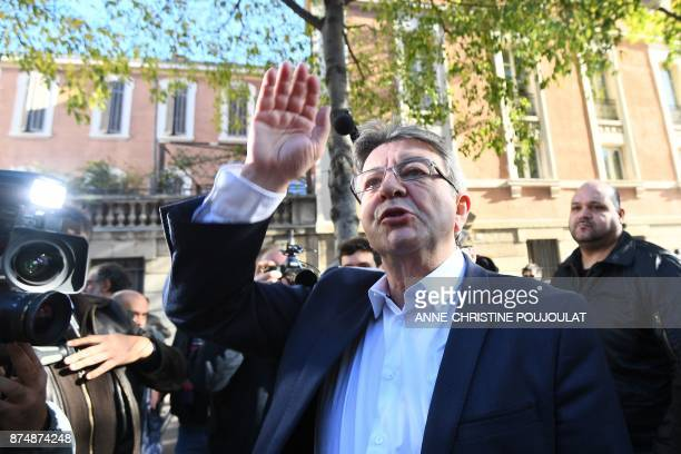 French MP and leader of the leftist party La France Insoumise JeanLuc Melenchon waves during a nationwide protest day against the government's...