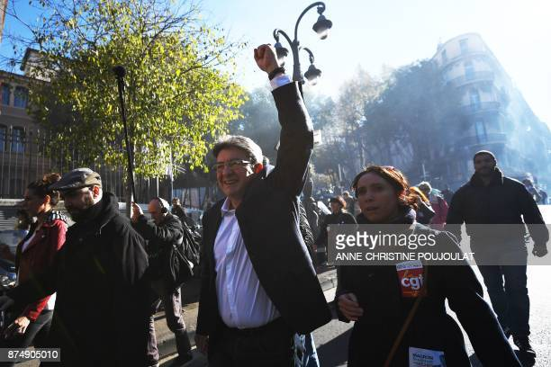 French MP and leader of the leftist party La France Insoumise JeanLuc Melenchon raises his fist during a nationwide protest day against the...