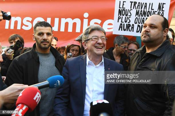 French MP and leader of the leftist party La France Insoumise JeanLuc Melenchon smiles during a nationwide protest day against the government's...
