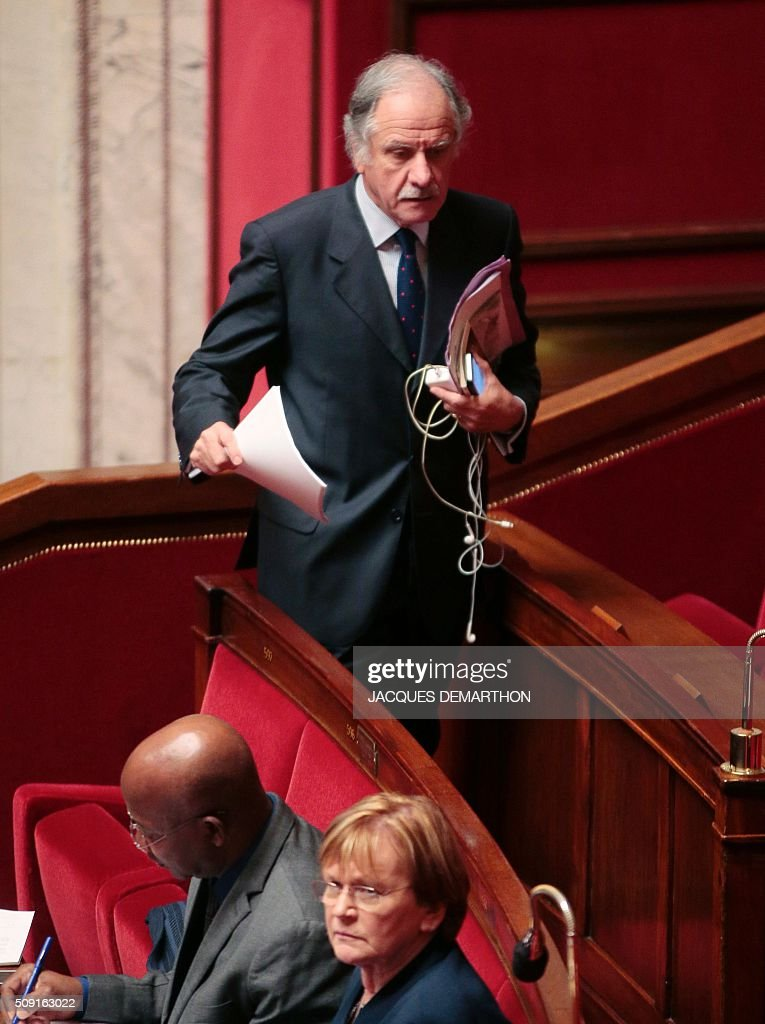 French MP Noel Mamere arrives at the French National Assembly in Paris on February 9, 2016, as French lawmakers examined proposed changes to the constitution. France's lower house of parliament is to vote on plans to enshrine a state of emergency into the constitution, including a controversial measure to strip French nationality from those convicted of terrorism and serious crimes. / AFP / JACQUES DEMARTHON
