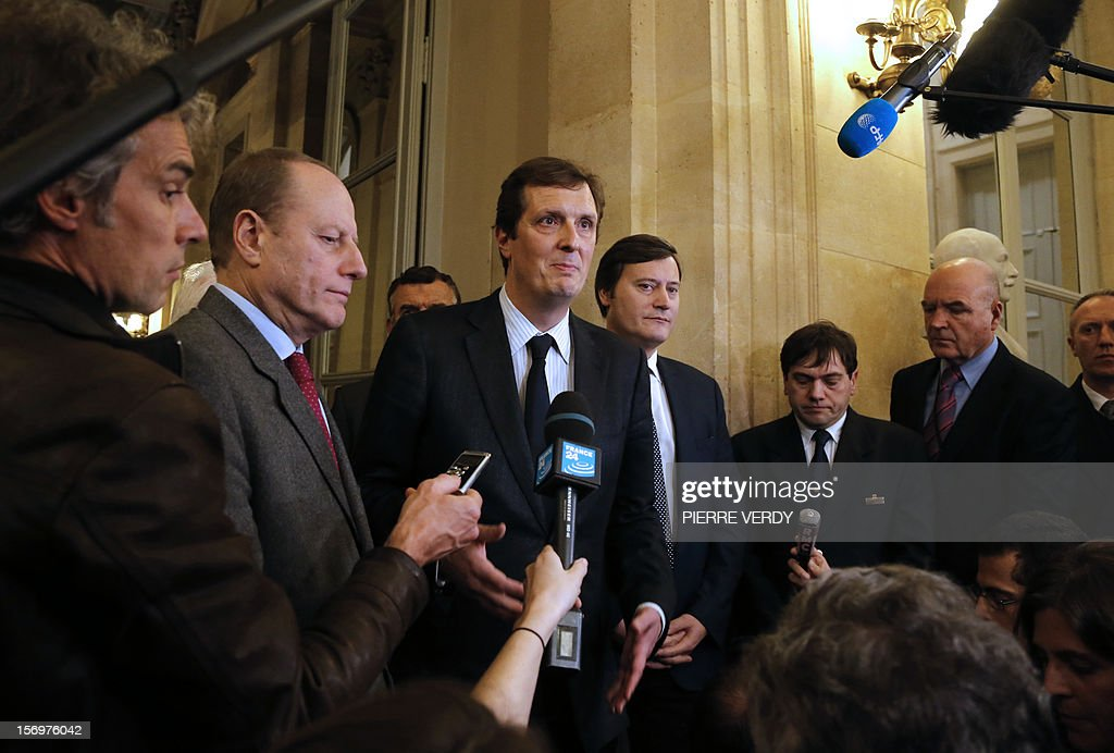 French MP of right-wing opposition party UMP, Jerome Chartier (C), ally of former prime Minister Francois Fillon, the defeated candidate for the leadership of the UMP speaks to journalists on November 26, 2012 in Paris at the National Assembly. The statement takes part after the meeting of the UMP's appeal elections control board which confirmed the decision of the UMP's elections control committee (COCOE) declaring the victory of Jean-Francois Cope as new president of UMP, elected on November 18, 2012. The appeal followed the failure of a mediation with the right-winger Cope, who was declared the winner of November 22 knife-edge vote to pick a party leader, Jean-Francois Cope, and his centrist rival Francois Fillon. Second left, Paris 15th district Mayor and UMP MP, Philippe Goujon. AFP PHOTO PIERRE VERDY