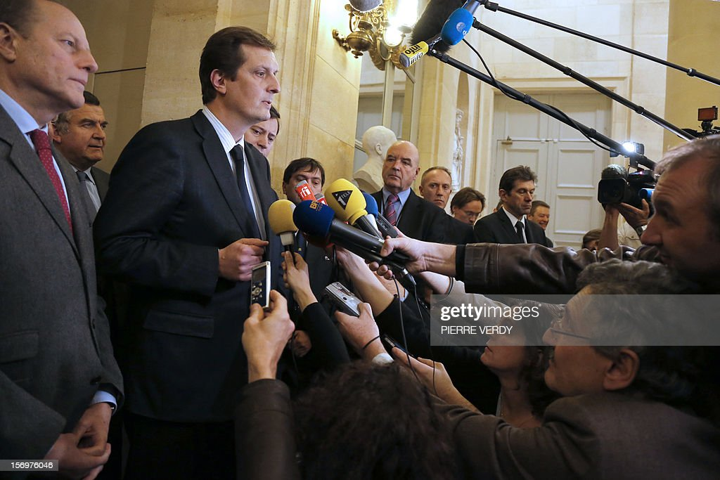 French MP of right-wing opposition party UMP, Jerome Chartier (2ndL), ally of former prime Minister Francois Fillon, the defeated candidate for the leadership of the UMP speaks to journalists on November 26, 2012 in Paris at the National Assembly. The statement takes part after the meeting of the UMP's appeal elections control board which confirmed the decision of the UMP's elections control committee (COCOE) declaring the victory of Jean-Francois Cope as new president of UMP, elected on November 18, 2012. The appeal followed the failure of a mediation with the right-winger Cope, who was declared the winner of November 22 knife-edge vote to pick a party leader, Jean-Francois Cope, and his centrist rival Francois Fillon. At left, Paris 15th district Mayor and UMP MP, Philippe Goujon AFP PHOTO PIERRE VERDY