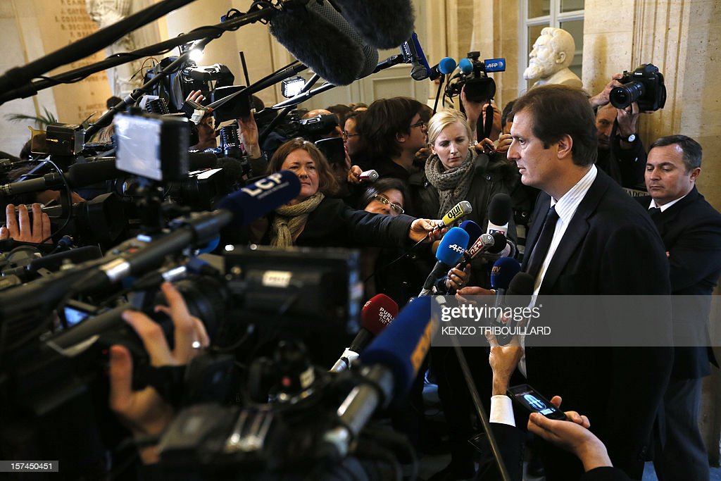 French MP of right-wing opposition party UMP, Jerome Chartier (R), ally of former prime Minister Francois Fillon, the defeated candidate for the leadership of the UMP, speaks to journalists on December 3, 2012 in Paris at the National Assembly, following a meeting between newly-elected President of the UMP, Jean-Francois Cope and Francois Fillon. The two politicians, Cope and Fillon, engaged in a shambolic battle to lead France's right-wing opposition met in a last-ditch bid to reach a deal ahead of a deadline imposed by ex-president Nicolas Sarkozy if they don't stop squabbling.