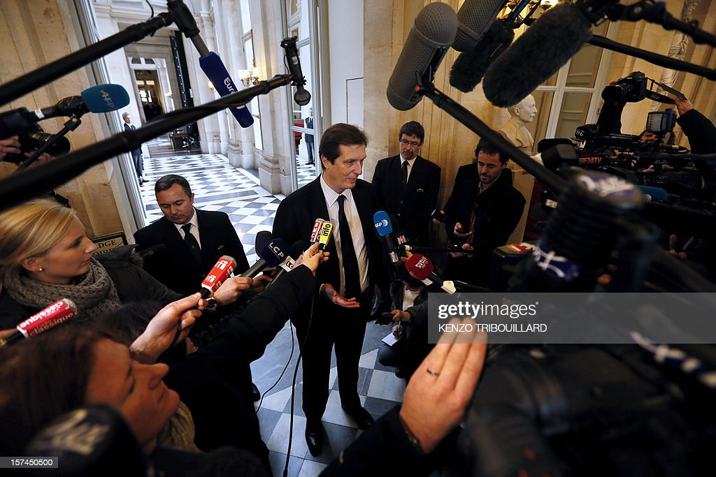 French MP of right-wing opposition party UMP, Jerome Chartier, ally of former prime Minister Francois Fillon, the defeated candidate for the leadership of the UMP, speaks to journalists on December 3, 2012 in Paris at the National Assembly, following a meeting between newly-elected President of the UMP, Jean-Francois Cope and Francois Fillon. The two politicians, Cope and Fillon, engaged in a shambolic battle to lead France's right-wing opposition met in a last-ditch bid to reach a deal ahead of a deadline imposed by ex-president Nicolas Sarkozy if they don't stop squabbling. AFP PHOTO KENZO TRIBOUILLARD
