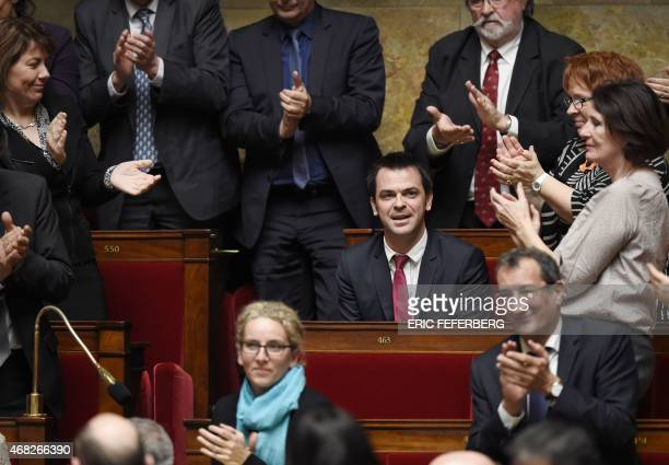 French MP of the Isere department Olivier Veran is applauded during the questions to the government session on April 1 2015 at the National Assembly...
