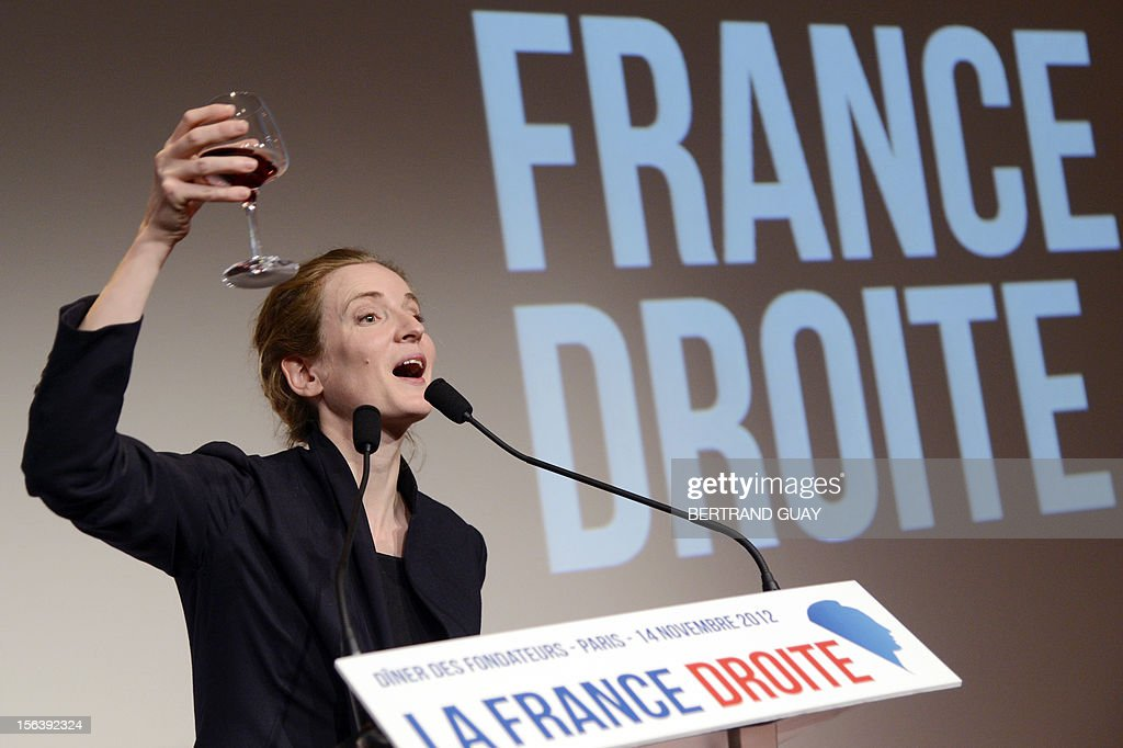 French MP of the Union for a Popular Movement right-wing opposition party (UMP) and former Minister, Nathalie Kosciusko-Morizet toasts with a glass of wine after delivering a speech during the launching of her political movement 'La France Droite', on November 14, 2012 in Paris.