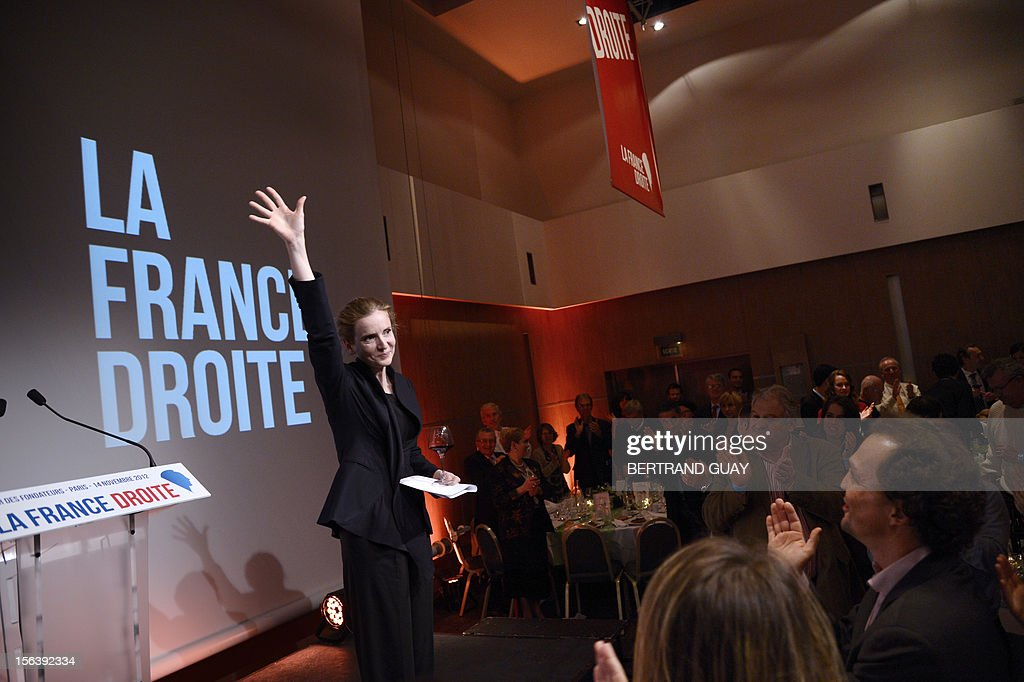 French MP of the Union for a Popular Movement right-wing opposition party (UMP) and former Minister, Nathalie Kosciusko-Morizet waves after delivering a speech during the launching of her political movement 'La France Droite', on November 14, 2012 in Paris.