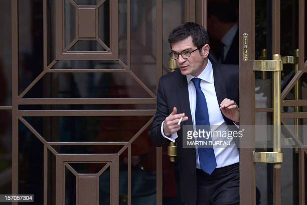 French MP of the Union for a Popular Movement rightwing opposition party Benoist Apparu holding a cigarette leaves the National Assembly in Paris on...