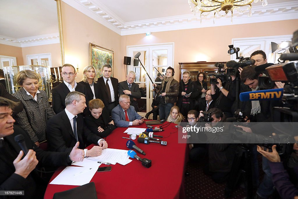 French MP of the Union for a Popular Movement right-wing opposition party (UMP) and former Minister, David Douillet (L) speaks beside former ministers Bruno Le Maire (2ndL) and Nathalie Kosciusko-Morizet (3rdL) during a press conference on December 04, 2012, at the French National Assembly in Paris. The so-called 'non-aligned' UMP members, headed by Le Maire and Kosciusko-Morizet, claimed a re-election by spring 2013 to settle the UMP leadership dispute and asked the right-wing UMP movement to hold a congress.