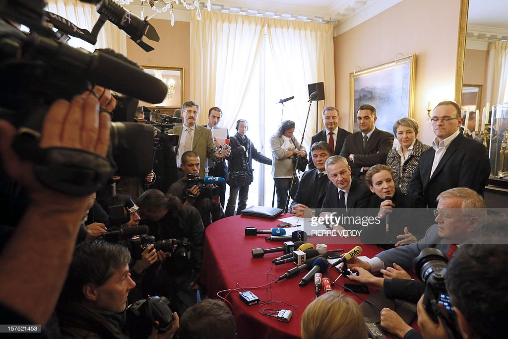 French MP of the Union for a Popular Movement right-wing opposition party (UMP) and former Minister, Nathalie Kosciusko-Morizet (2nd R) and French UMP's MP and former Minister, Bruno Le Maire (3rd R) give a press conference on December 04, 2012 at the French National Assembly in Paris. The so-called 'non-aligned' UMP members, headed by Le Maire and Kosciusko-Morizet, claimed a re-election by spring 2013 to settle the UMP leadership dispute and asked the right-wing UMP movement to hold a congress. French MP of the Union for a Popular Movement right-wing opposition party (UMP) and former Minister, David Douillet (L). AFP PHOTO KENZO TRIBOUILLARD