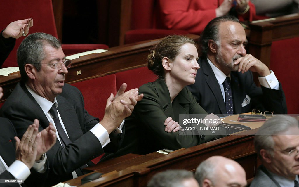 French MP Patrick Balkany (L), former UMP's Minister Nathalie Kosciusko-Morizet and MP Olivier Dassault attend a weekly session of questions to the government on January 29, 2013 at the National Assembly in Paris.