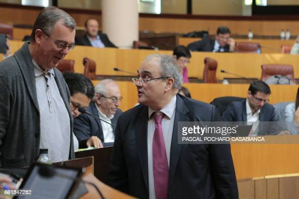 French MP Paul Giacobbi speaks with Propriano's mayor PaulMarie Bartoli during a Corsican assembly session on March 30 2017 in Ajaccio on the French...