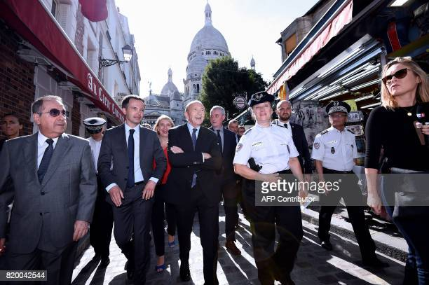 French MP PierreYves Bournazel walks along side French Minister of the Interior Gerard Collomb as they make their way along a street leading from the...