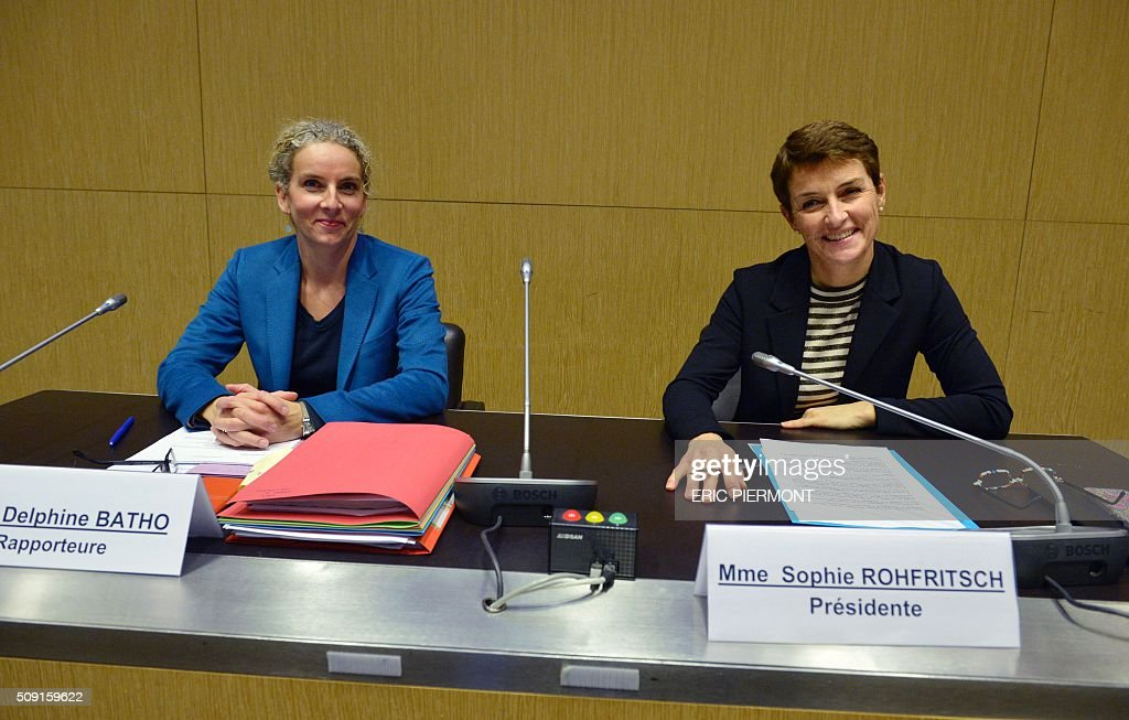 French MP Sophie Rohfritsch (R) and French MP Delphine Batho (L) pose during the hearing of the president of Volkswagen Group France Jacques Rivoal by a National Assembly Information Mission at the National Assembly in Paris on February 9, 2016. / AFP / ERIC PIERMONT