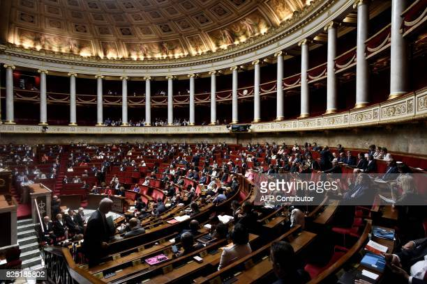 French MPs attend a session at the French National Assembly on a bill allowing the government to change some policies in the labour sector using...