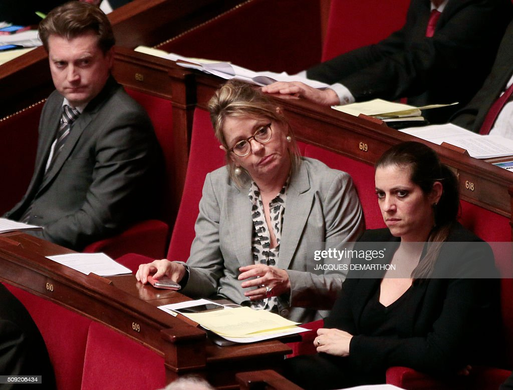 French MPs (from L) David Comet, Anne-Christine Lang, and Julie Sommaruga attend the debate at the French National Assembly in Paris on February 9, 2016, as French lawmakers examined proposed changes to the constitution. France's lower house of parliament is to vote on plans to enshrine a state of emergency into the constitution, including a controversial measure to strip French nationality from those convicted of terrorism and serious crimes. / AFP / JACQUES DEMARTHON