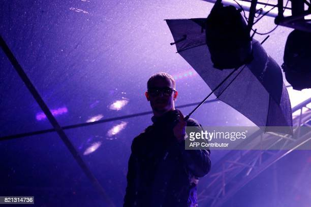 French musician DJ Snake performs during the Lollapalooza music festival at the Longchamp Hippodrome in Paris on July 23 2017 / AFP PHOTO / GEOFFROY...