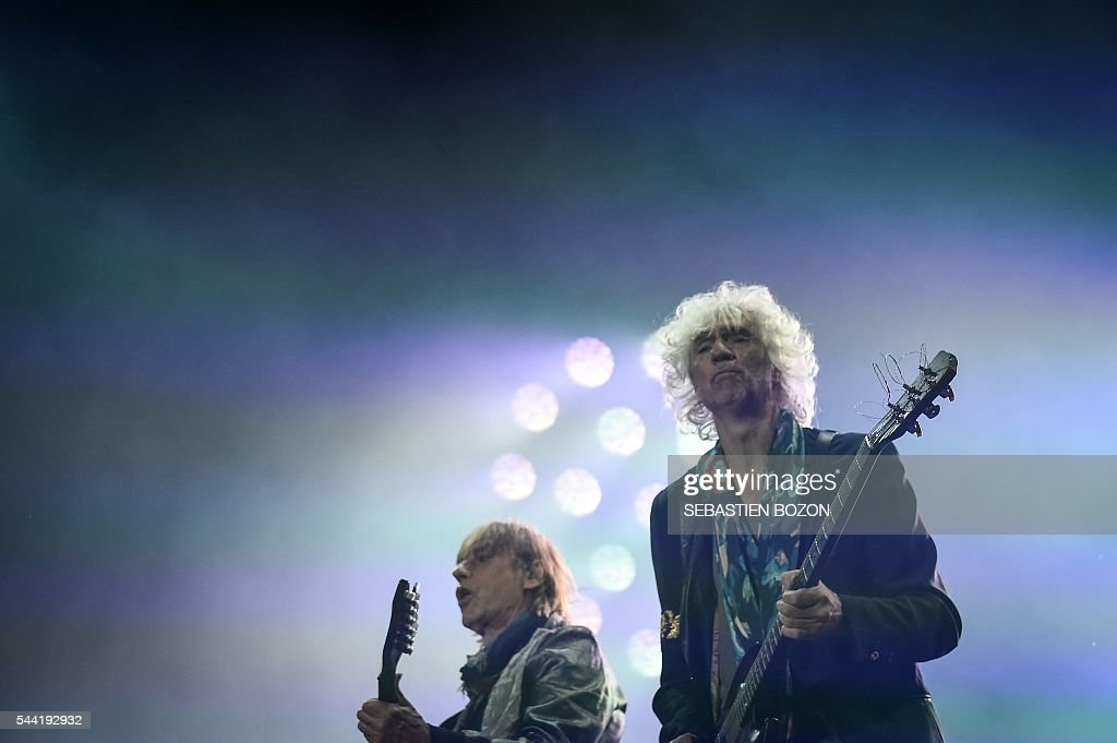 French musicians Jean-Louis Aubert (L) and Louis Bertignac of Les Insus perform on stage during the 28th Eurockeennes rock music festival on July 1, 2016 in Belfort. / AFP / Sebastien Bozon